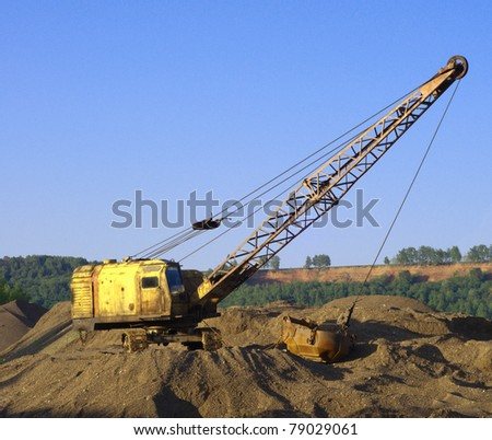 close up of a excavator on a macadam - stock photo
