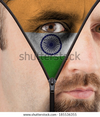 close-up of a face unzipping to show the flag of India - stock photo