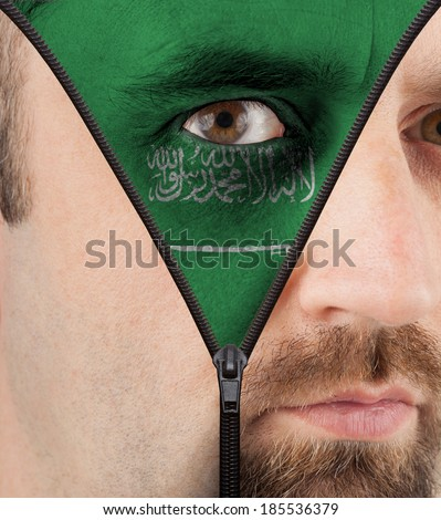 close-up of a face unzipping to show the flag of Saudi Arabia - stock photo