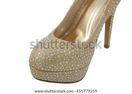 Close-up of a fashionable high-heeled shoe, gold fabric covered in glittering gems, isolated on a white background - stock photo