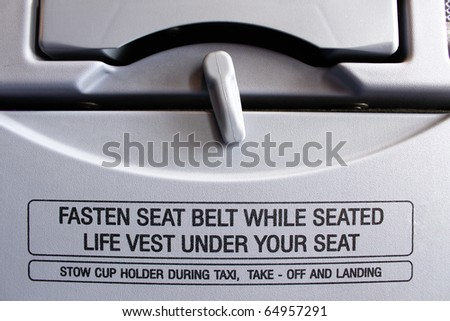 """Close-up of a """"FASTEN SEAT BELT WHILE SEATED"""" - stock photo"""