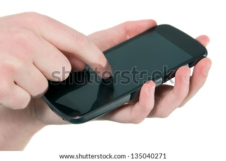 Close up of a female hand using a mobile phone - stock photo