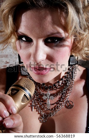 Close up of a female punk rocker performing a song
