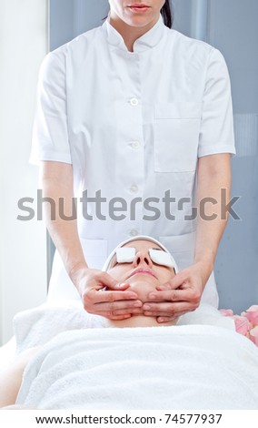 Close-up of a female receiving facial massage at spa salon