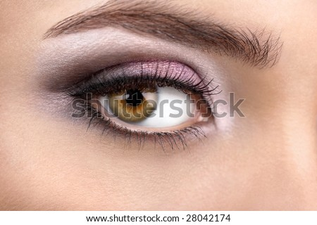 Close up of a female right eye with a bright make-up - stock photo