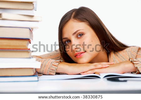 Close-up of a female student with a books
