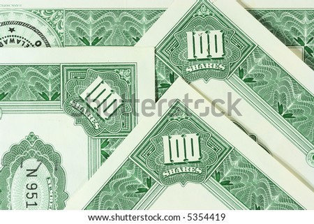 Close-up of a few 100 shares certificates. Vintage scripophily objects. - stock photo