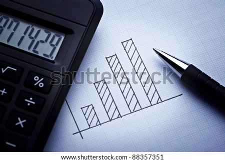 close up of a finance graph on an office desk - stock photo
