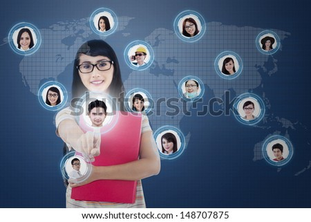 Close-up of a finger clicking on digital social network on blue background   (All model releases for 12 models are attached) - stock photo