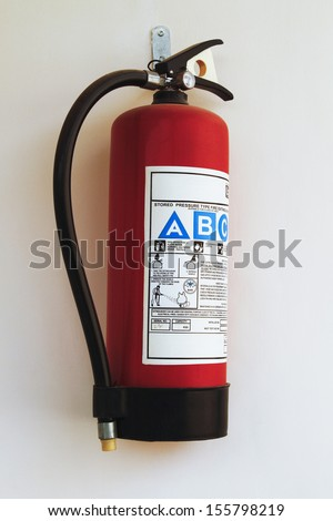 Close-up of a fire extinguisher - stock photo