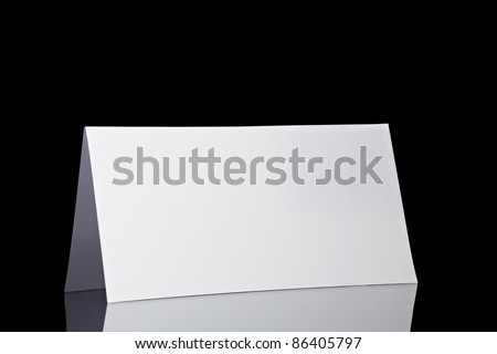 close up of  a folded card on black  background  with clipping path - stock photo