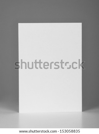 close up of a folded card on gray background with clipping path - stock photo