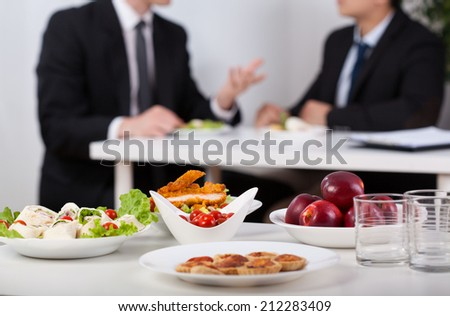 Close-up of a food and men during lunch break - stock photo