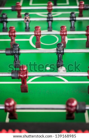 Close up of a foosball game with soccer ball. - stock photo