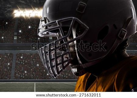 Close up of a Football orange with a white uniform on a stadium. - stock photo