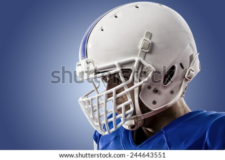 Close up of a Football Player with a blue uniform on a blue background. - stock photo