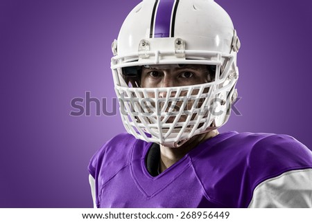Close up of a Football Player with a purple uniform on a purple background.