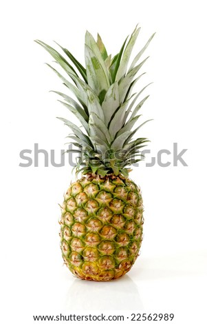 Close up of a fresh pineapple on bright background