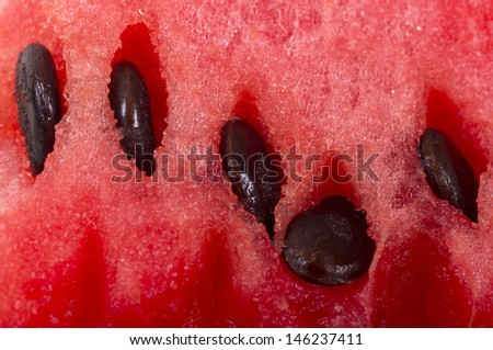 Close-up of a fresh slice of a red watermelon - stock photo