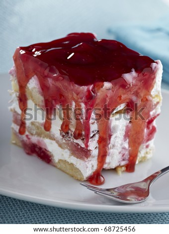 close up of a fruit cream cake on white plate - stock photo