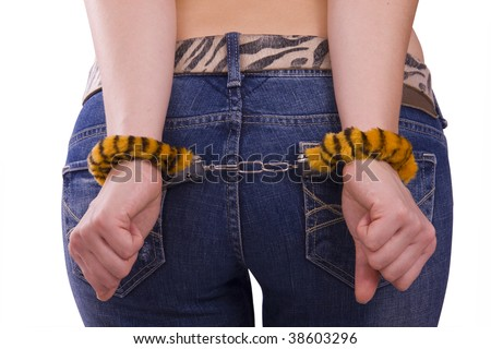 Close up of a girl?s hand in handcuffs. Woman's hands cuffed behind her back. Isolated on white background.