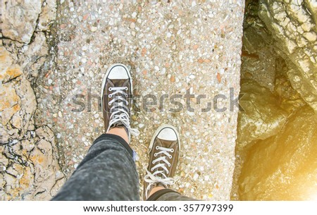 close up of a girl's shoes that walking alone-lifestyle concept - stock photo