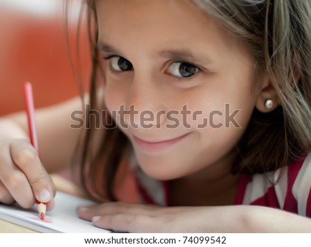 Close up of a girl working on her art project at home - stock photo