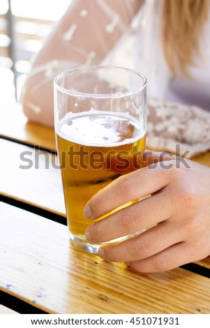 Close-up of a glass of beer/cider - stock photo