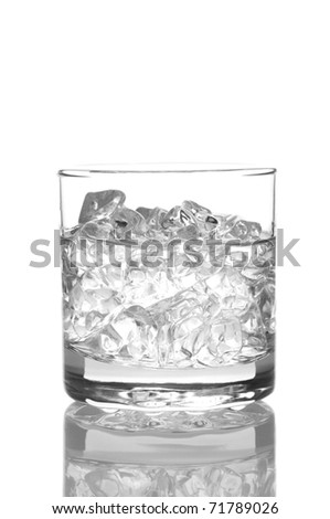 Close up of a glass of water or vodka with ice cubes. Vertical Format isolated on white with reflection. - stock photo