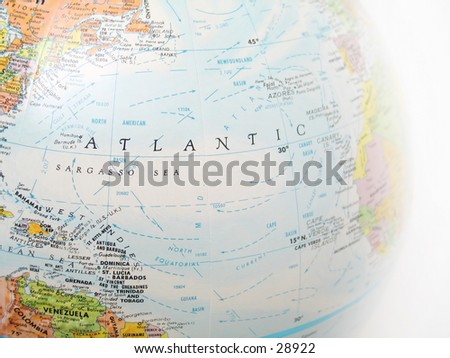 Close up of a globe, focused on Atlantic ocean and surrounding areas. - stock photo