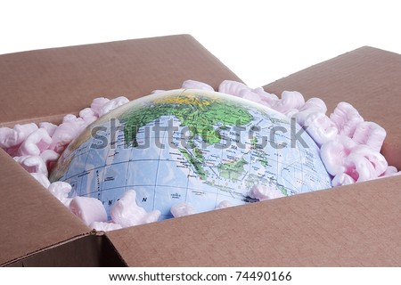 Close-up of a globe in a delivery box. - stock photo