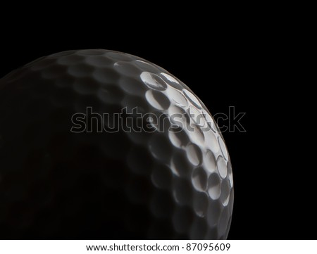 Close up of a golf ball on black - stock photo