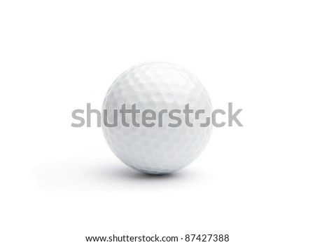 Close up of a golf ball on white background - stock photo