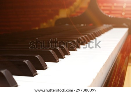 Close-up of a grand piano keyboard, shallow depth of field, with instagram style filter - stock photo