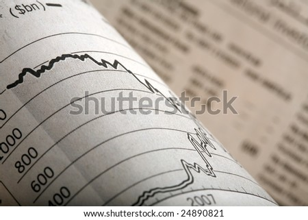 Close-up of a graph section of a financial newspaper - stock photo