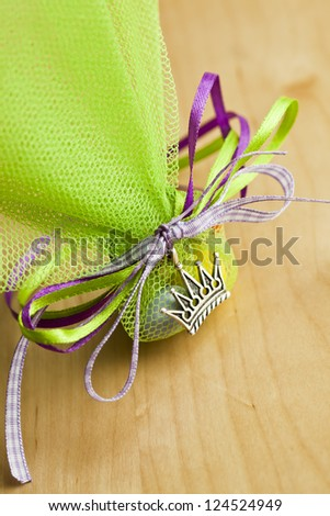 Close up of a green Christening Favor. - stock photo