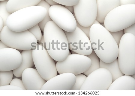 close up of a group of white sugared almonds - stock photo