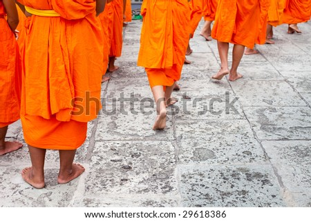 Close up of a group of young Buddhist novice monks walking - stock photo