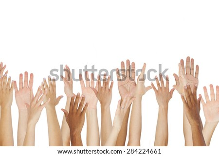 Close Up Of A Group Raising Their Hands