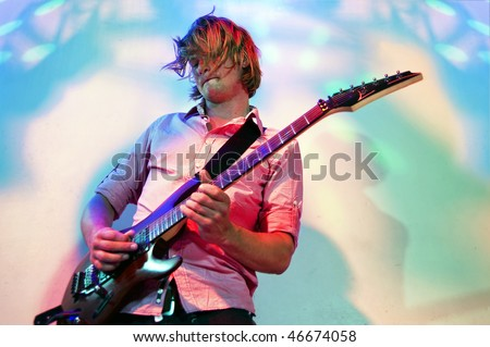 Close up of a guitarist during a concert solo - stock photo