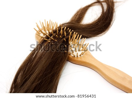 Close-up of a hairbrush with lost hair in it isolated on white. - stock photo