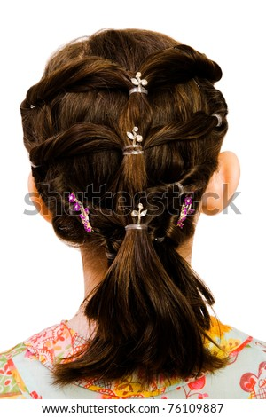 Close-up of a hairstyle of a girl isolated over white
