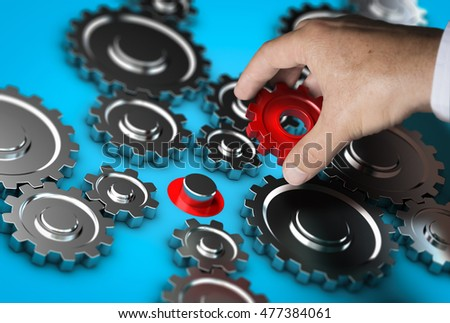 Close-up of a hand holding a red gear and positioning it at the right place. Abstract concept of leader or partnership. Composite image between a photography and a 3D background.