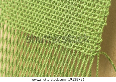 Close-up of a hand-loom weaving project, shallow dof. - stock photo