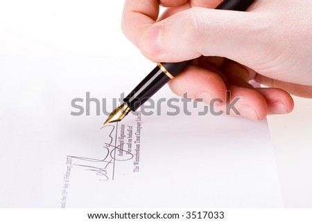 Close up of a hand signing a document. Please note that the signature is fictitious.