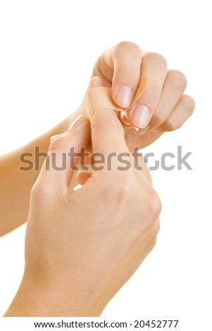 Close-Up of a hand with a band aid - stock photo