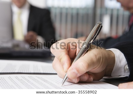 Close up of a hand writing on a document. - stock photo
