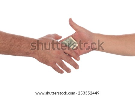close-up of a handshake with the transfer of money on white background studio - stock photo