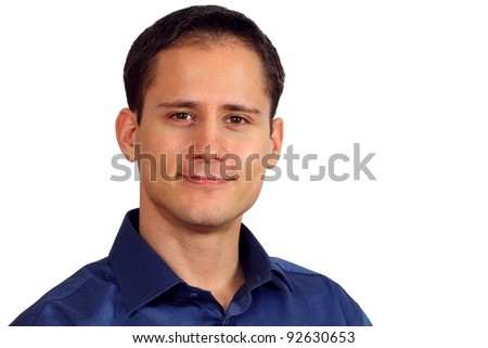 Close-up of a handsome young man in a blue shirt