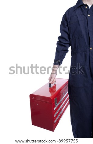 close up of a handyman in blue coveralls with a bright red toolbox - stock photo